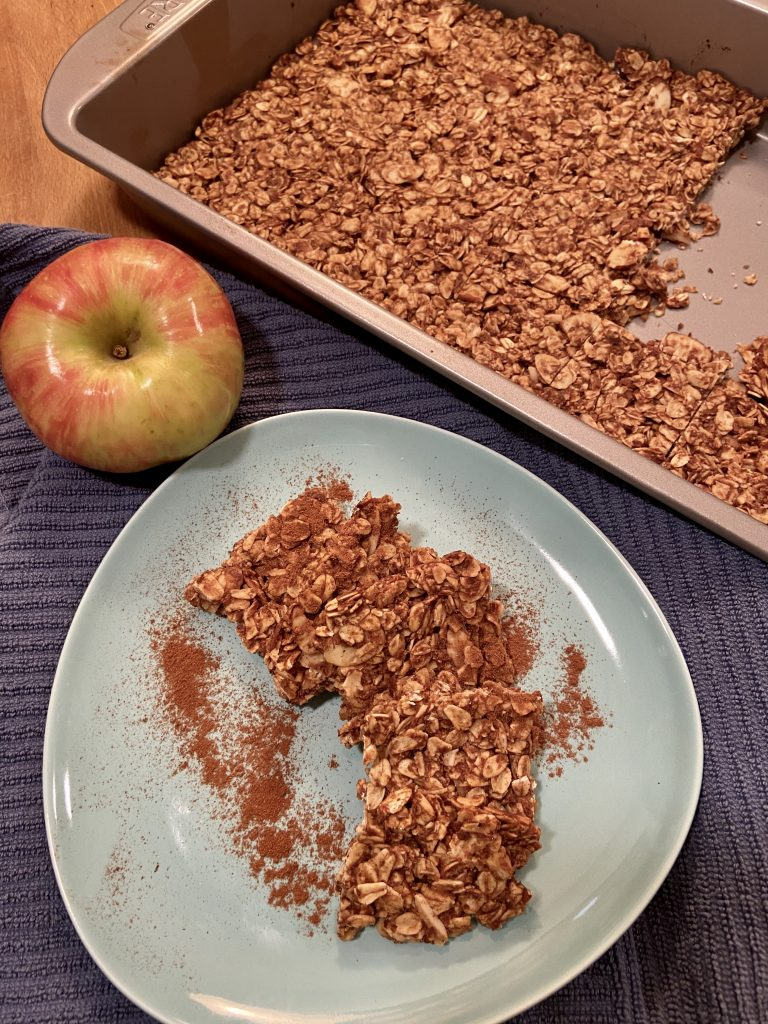 Apple oat bars with apple and tray in background